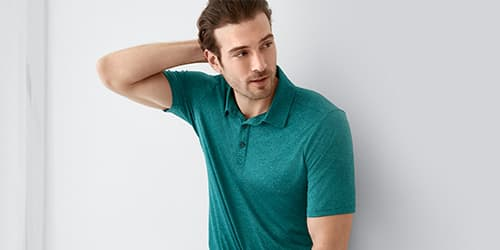 Man wearing a Space Dye Performance Polo
