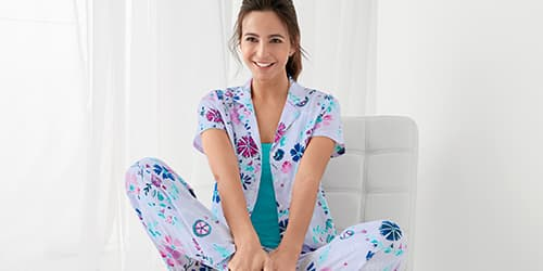 Woman lounging in NEW 100% cotton sleepwear