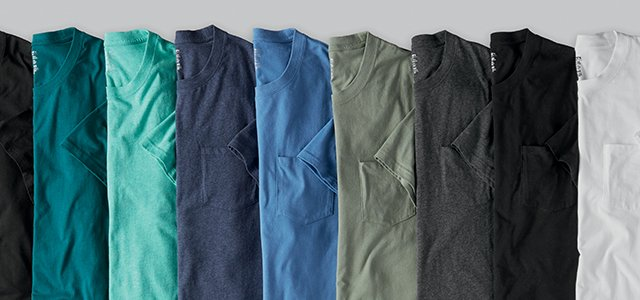 Stacks of folded crew and v-neck t-shrits