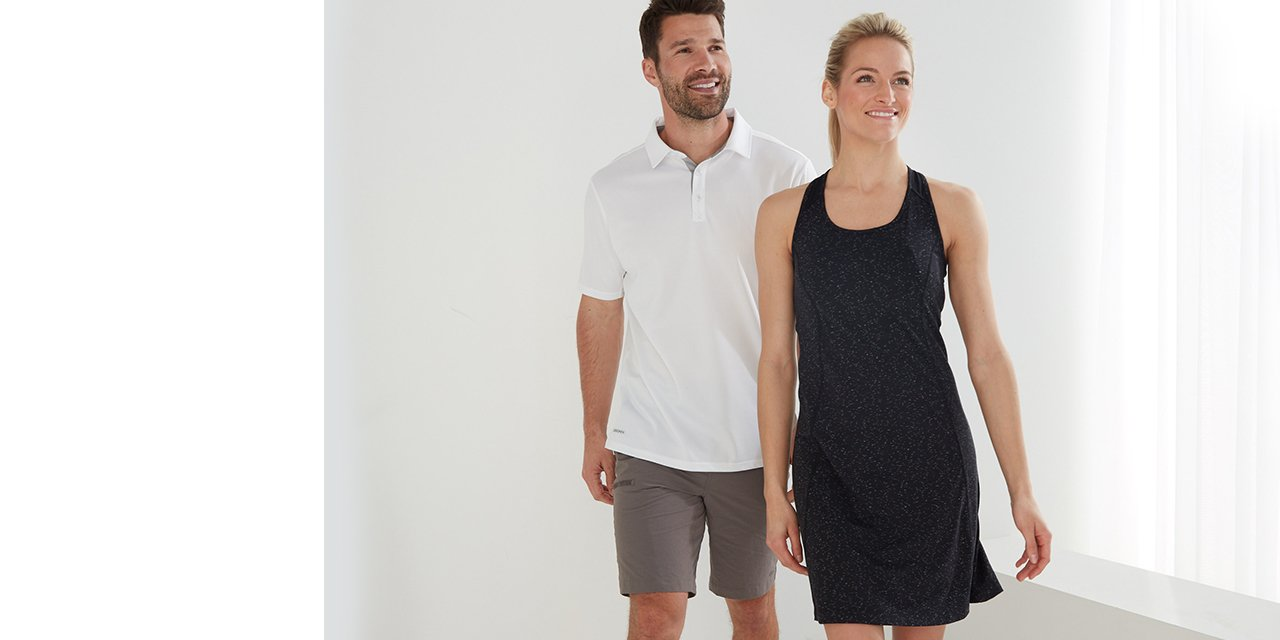 A couple wearing activewear polos
