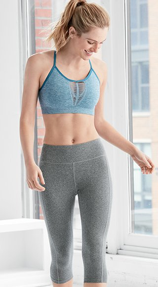 Woman wearing sports bra and activewear pants