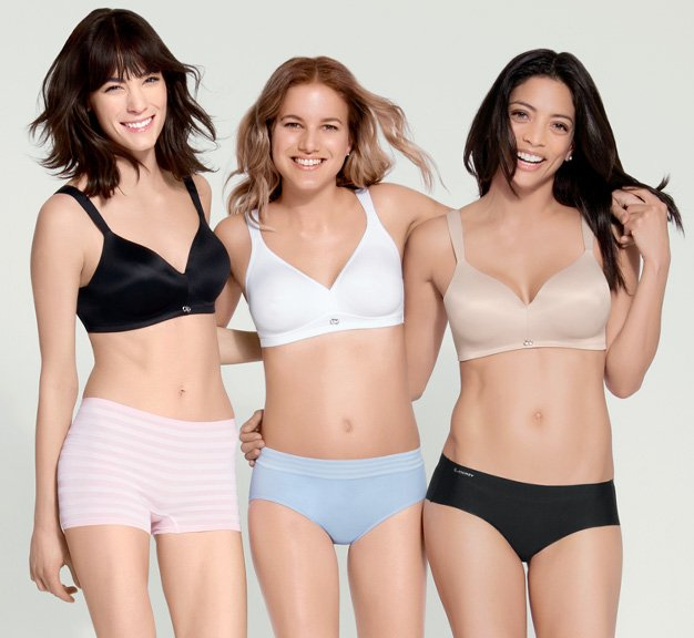 Women lined up wearing the Wire-Free Unlined RealFit Bra